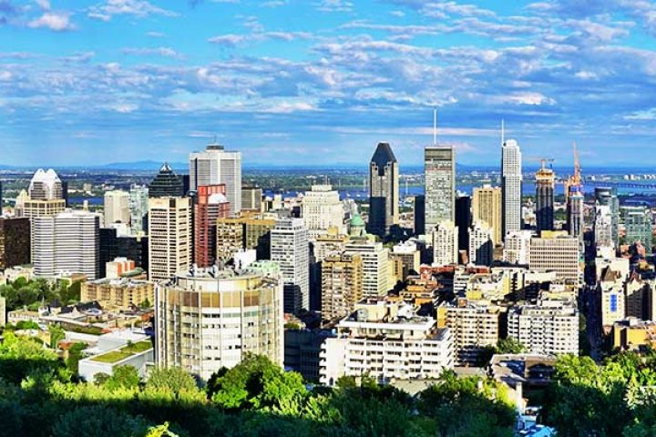Scenic panorama of the city of Montreal in Quebec from the Chalet du Mont Royal (Mount Royal Chalet) belvedere viewpoint.